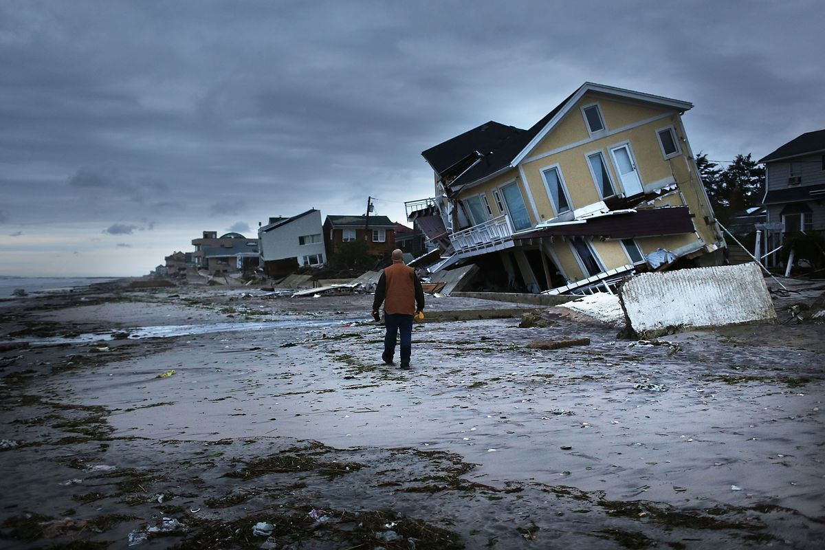 Damage is viewed in the Rockaway neighborhood where the historic boardwalk was washed away during Hurricane Sandy on October 31, 2012