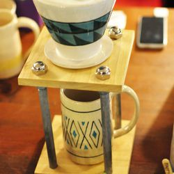 """<a href=""""http://kuzehpottery.blogspot.com/""""><b>Kuzeh Pottery's</b> co-owners <b>Tina Chiu and Pegah Shahghasemi</b> showed us their handcrafted clay/wood coffee maker (<b>$40</b>), which can easily be paired with their clay mugs (<b>$28</b>). All clay pie"""