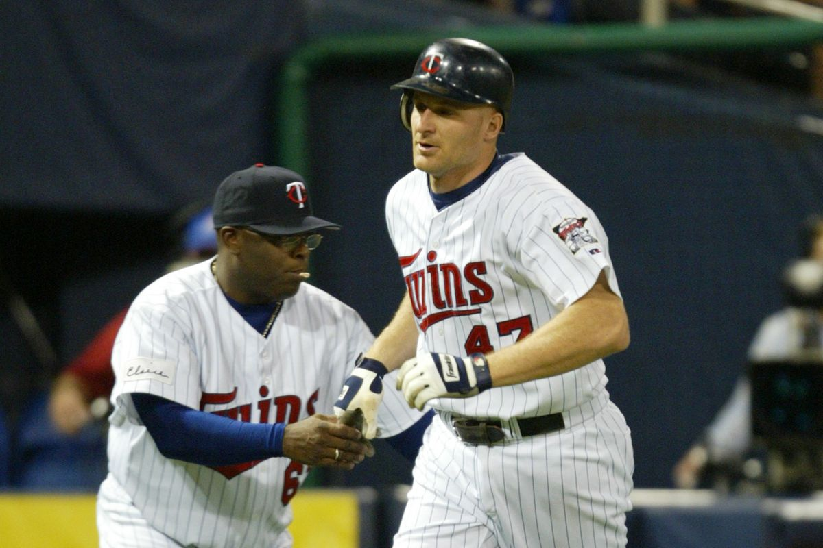 Jerry Holt/Star Tribune 6/29/2005 Twins vs White Sox #87337---Twins Corey Koskie rounding third base taps coach Al Newman hand after hitting home run in the 4th inning.