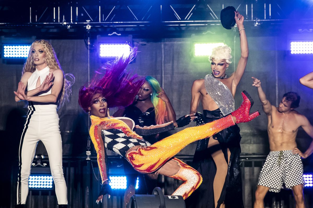 """Jaida Essence Hall (center), winner of the 12th season of """"RuPaul's Drag Race,"""" does a death drop during the final number of Drive 'N Drag Friday night at Soldier Field."""