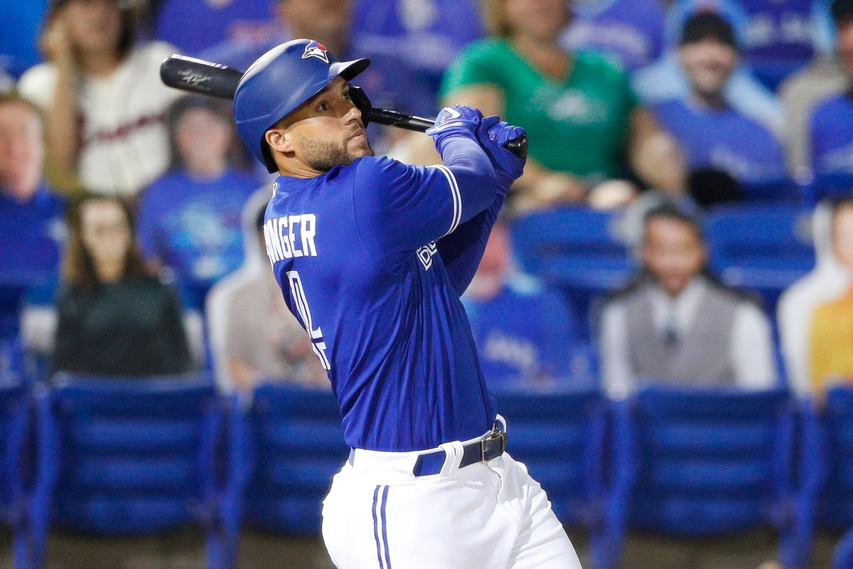 Toronto Blue Jays designated hitter George Springer (4) hits a two-run home run against Atlanta in the third inning at TD Ballpark.