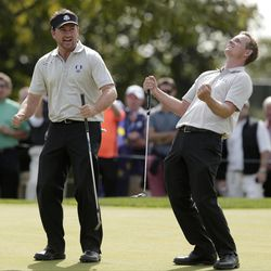 Europe's Luke Donald, right, reacts to a putt in front of Graeme McDowell on the ninth hole during a practice round at the Ryder Cup PGA golf tournament Wednesday, Sept. 26, 2012, at the Medinah Country Club in Medinah, Ill.