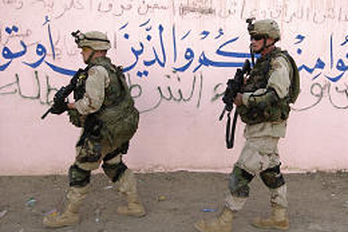U.S. Army soldiers patrol in Samarra, Iraq, Saturday. Sporadic fighting continued on the second day of a U.S. military incursion into the city.