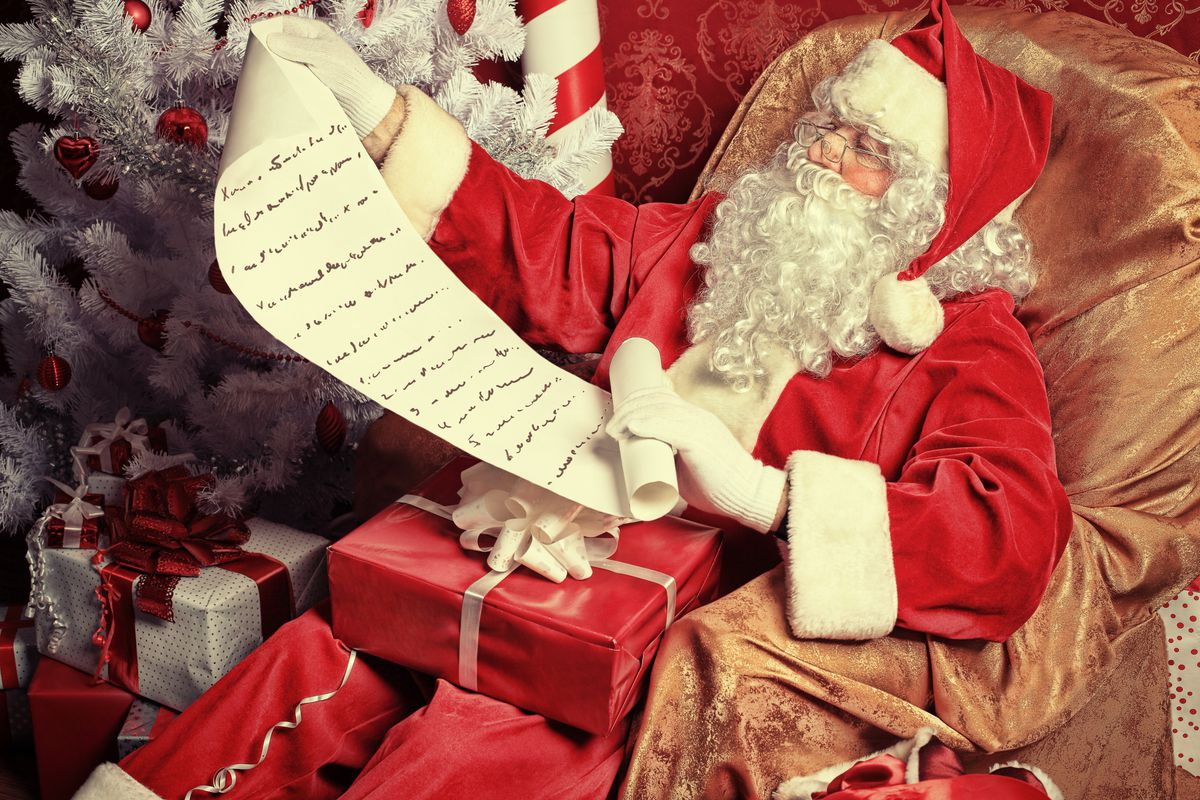 Father Christmas reads a letter.