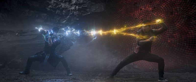 Two people in a marital arts-style battle appear to be sending lightning at one another.