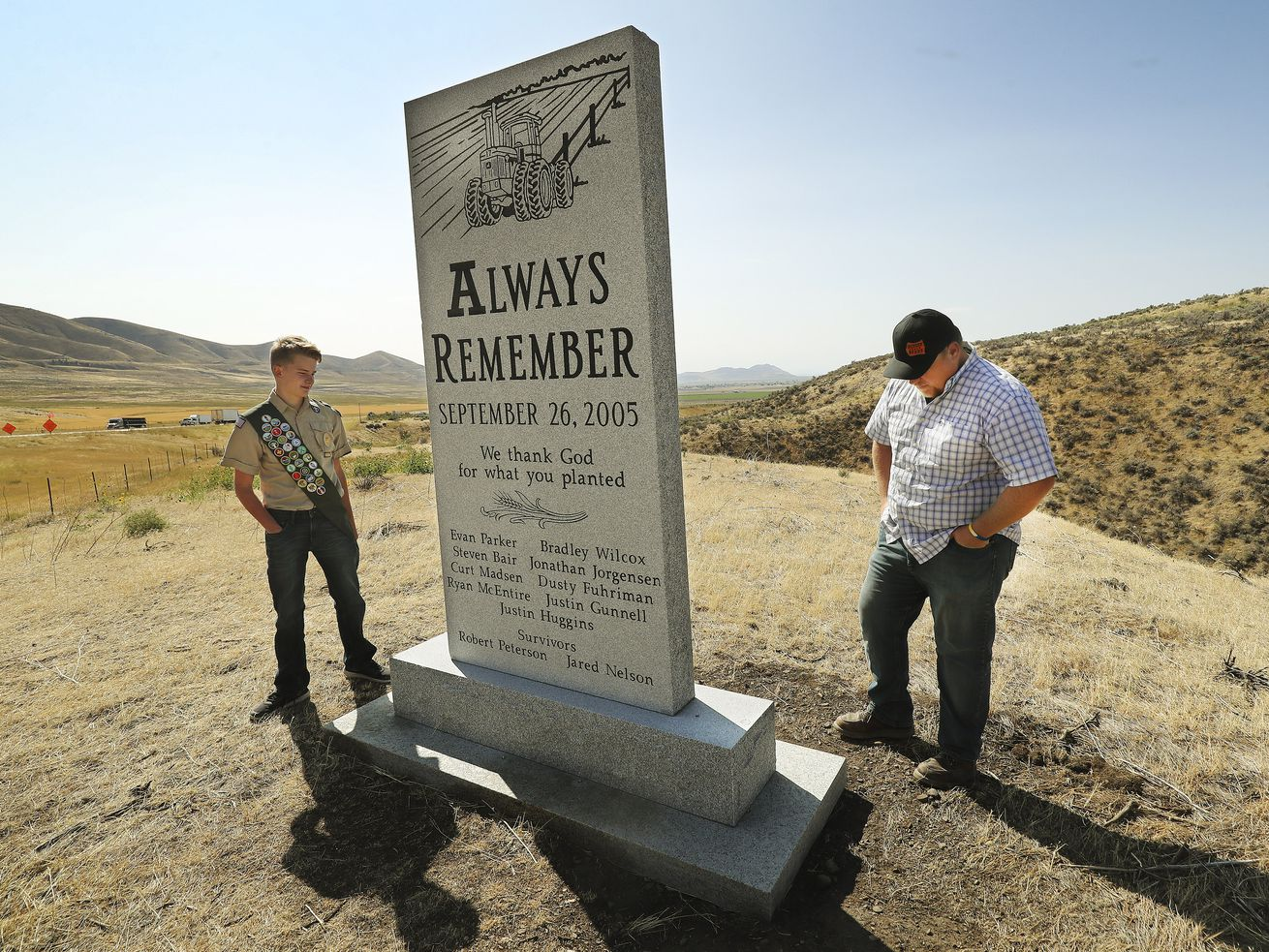 Eagle Scout Rusten Thornley and Robbie Petersen look over a monument dedicated to eight Utah State University agriculture students and an instructor who were killed in a 2005 van crash near Bothwell, Box Elder County, on Wednesday, Sept. 9, 2020.Petersen survived the crash, and Thornley raised the money for the monument.