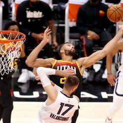 Utah Jazz center Rudy Gobert (27) battle for a rebound over Memphis Grizzlies center Jonas Valanciunas (17) as the Utah Jazz and the Memphis Grizzlies play in game 5 at Vivint Arena in Salt Lake City on Wednesday, June 2, 2021.