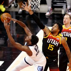Utah Jazz center Derrick Favors (15) fouls Memphis Grizzlies forward Jaren Jackson Jr. (13) as the Utah Jazz and Memphis Grizzlies play Game 2 of their NBA playoffs first round series at Vivint Arena in Salt Lake City on Wednesday, May 26, 2021.