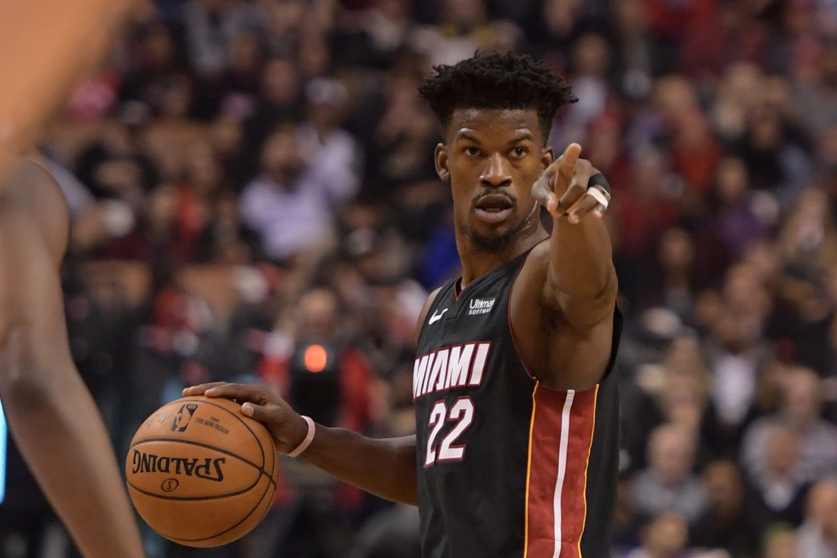 Miami Heat forward Jimmy Butler controls the ball in the first half against Toronto Raptors at Scotiabank Arena.