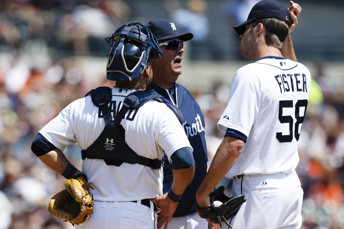 Detroit Tigers pitching coach Jeff Jones (center) talks to starting pitcher Doug Fister (58) and catcher Gerald Laird (9) during the second inning against the Baltimore Orioles at Comerica Park. Mandatory Credit: Rick Osentoski-US PRESSWIRE