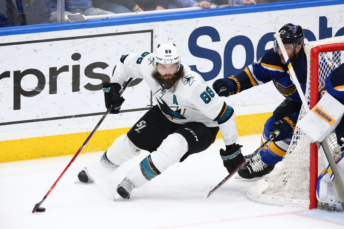 Mar 27, 2018; St. Louis, MO, USA; San Jose Sharks defenseman Brent Burns (88) skates the puck from behind the net as he is pressured by St. Louis Blues defenseman Alex Pietrangelo (27) in overtime at Scottrade Center. The Blues won 3-2.