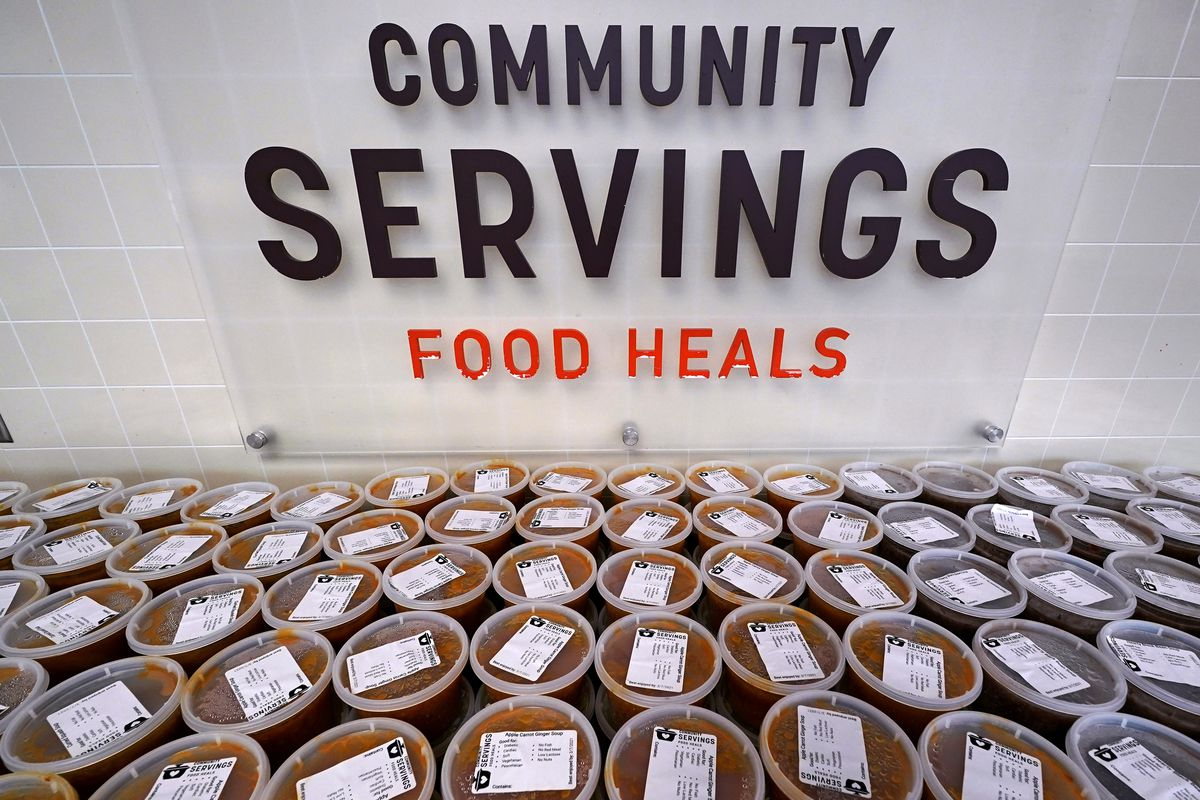 Hundreds of containers of soup are prepared for clients at Community Servings, which prepares and delivers scratch-made, medically tailored meals to people with critical and chronic illnesses, in Boston's Jamaica Plain neighborhood.