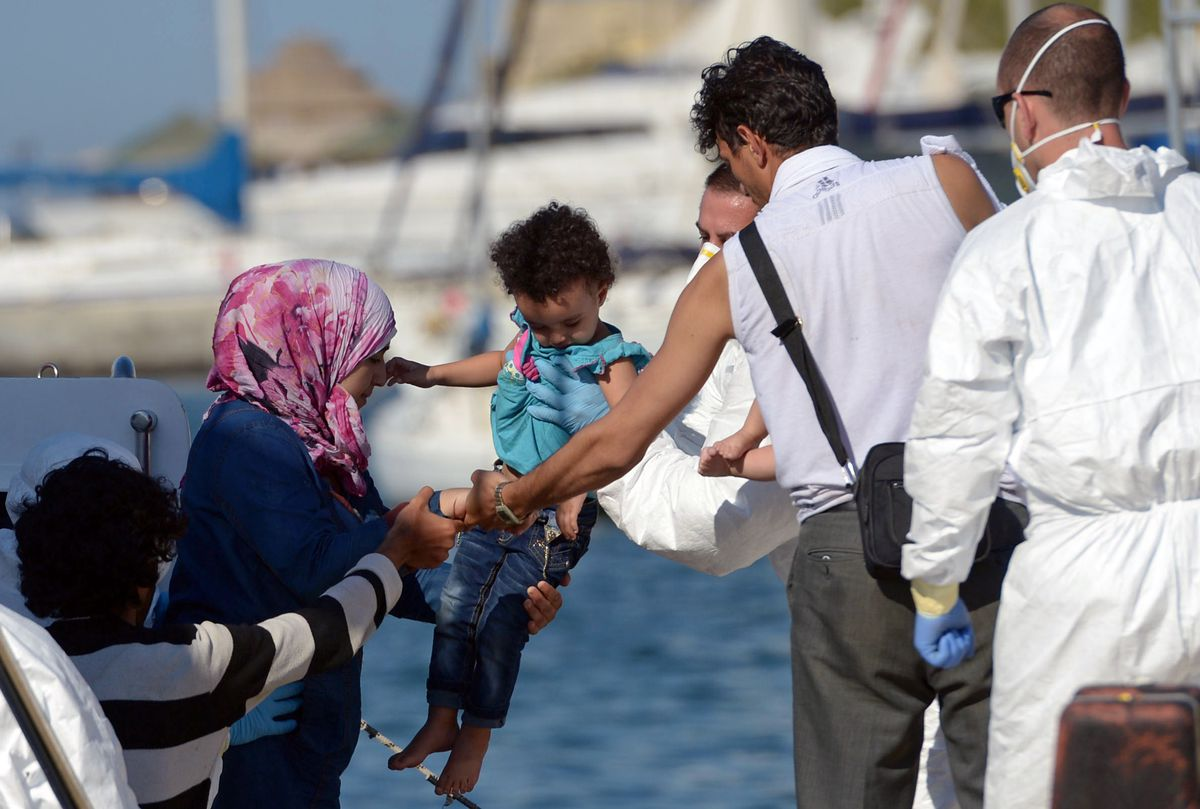 Rescued migrant family