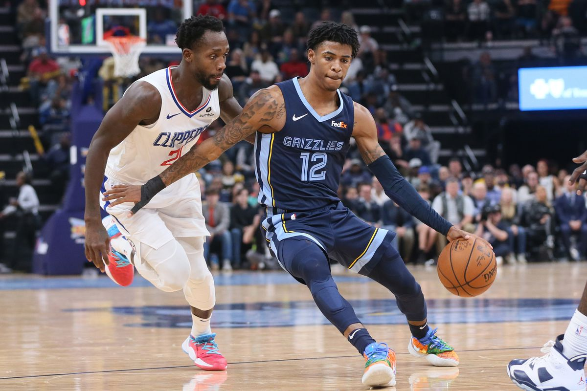 Memphis Grizzlies guard Ja Morant dribbles around Los Angeles Clippers guard Patrick Beverly  at FedExForum. Clippers won 121-119.