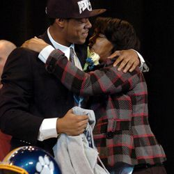 Valley View High School football senior Nyeem Wartman embraces his mother Veronica White after signing his letter of intent to attend Penn State University and play football on national signing day, Wednesday, Feb. 1, 2012 at Valley View High School in Archbald, Penn.