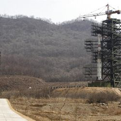 North Korea's Unha-3 rocket, slated for liftoff between April 12-16, stands at Sohae Satellite Station in Tongchang-ri, North Korea on Sunday April 8, 2012. North Korean space officials have moved a long-range rocket into position for this week's controversial satellite launch, vowing Sunday to push ahead with their plans in defiance of international warnings against violating a ban on missile activity.(AP Photo/Ng Han Guan)