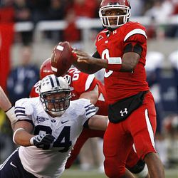 Utah's Brian Johnson throws downfield as Jan Jorgensen rushes as the University of Utah and Brigham Young University play last year.