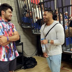 BYU wide receiver Puka Nacua and Harvey Langi, New England Patriots linebacker and former BYU player, talk at a Powder League basketball game at American Preparatory Academy in Draper on Friday, June 25, 2021.