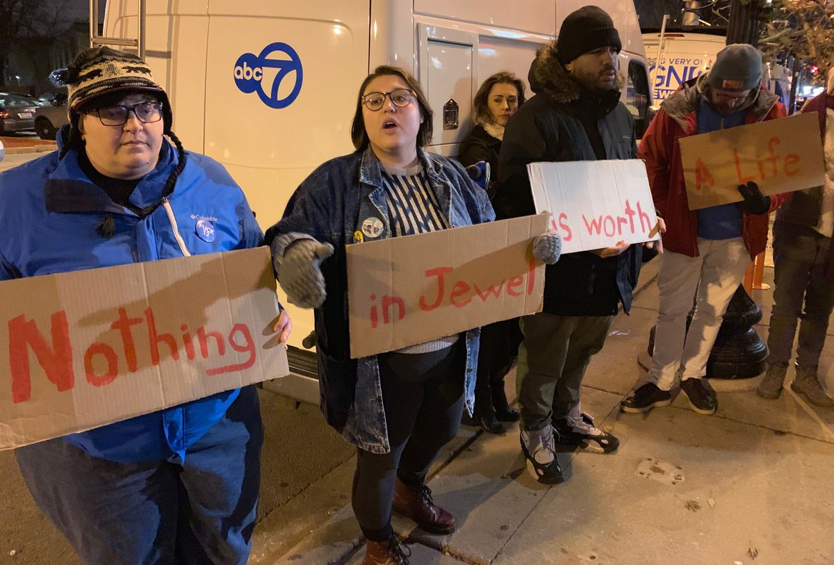 Lake View community activist Erica Kadel (second-from left) calls on Jewel-Osco to release details about a suspected shoplifter's death last week during a protest on Wednesday.