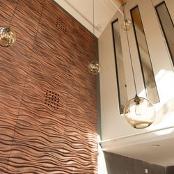 The wall behind the bar, made of MDF and custom-routed. At night LEDs above will give the appearance of ocean ripples.