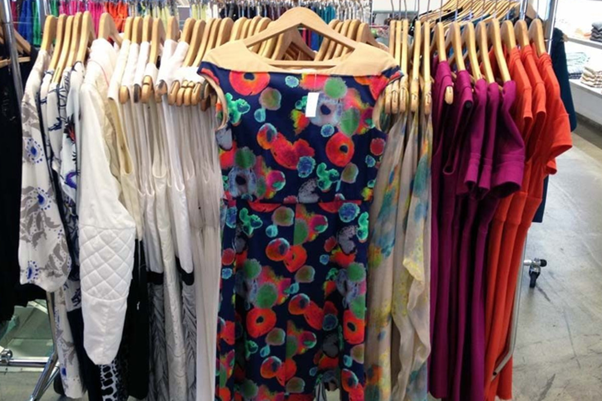 """A rack of dresses from the <a href=""""http://ny.racked.com/archives/2012/08/27/scoops_big_summer_sale_takes_halfoff_everything.php"""">summer sale</a>"""