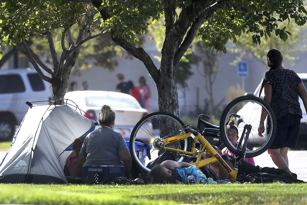 People camp in the park strip along 700 South near State Street in Salt Lake City on Tuesday, Aug. 11, 2020.