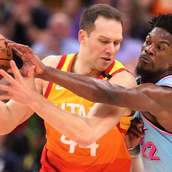 Utah Jazz forward Bojan Bogdanovic (44) works to keep Miami Heat forward Jimmy Butler (22) away from the ball as the Utah Jazz and the Miami Heat play in an NBA basketball game at Vivint Smart Home Arena in Salt Lake City on Wednesday, Feb. 12, 2020. Utah won 116-101.