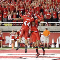 Utah Utes wide receiver Dres Anderson (6) celebrates his touchdown with teammate Utah Utes running back Lucky Radley (44) in Salt Lake City  Sunday, Sept. 16, 2012.