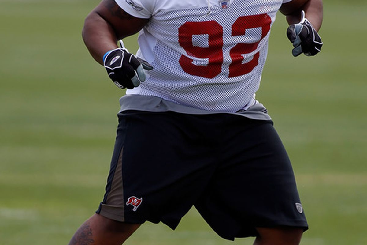 TAMPA, FL - MAY 01:  Defensive tackle Brian Price #92 of the Tampa Bay Buccaneers warms up during the Buccaneers Rookie Minicamp at One Buccaneer Place on May 1, 2010 in Tampa, Florida.  (Photo by J. Meric/Getty Images)