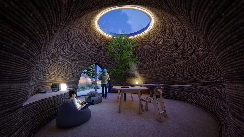 Rendering of people inside 3d-printed home at night.
