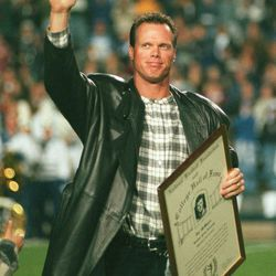 Jim McMahon is honored at halftime of the BYU vs. San Diego State game in 1998.