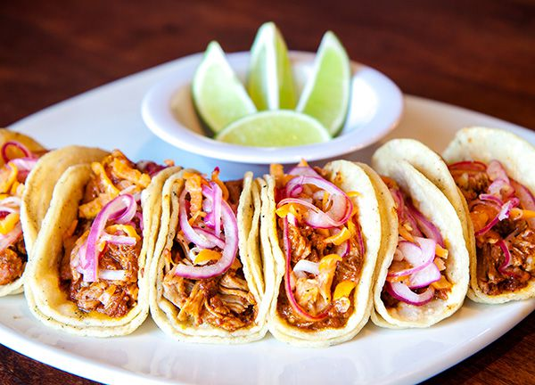 A semi-circle of tacos
