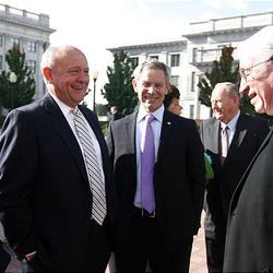 Former U.S. Sen. Jake Garn, Salt Lake Chamber of Commerce President Lane Beattie, Salt Lake Mayor Ralph Becker and Deseret Management Corp. CEO Mark Willes talk after signing the compact Thursday at the Capitol.
