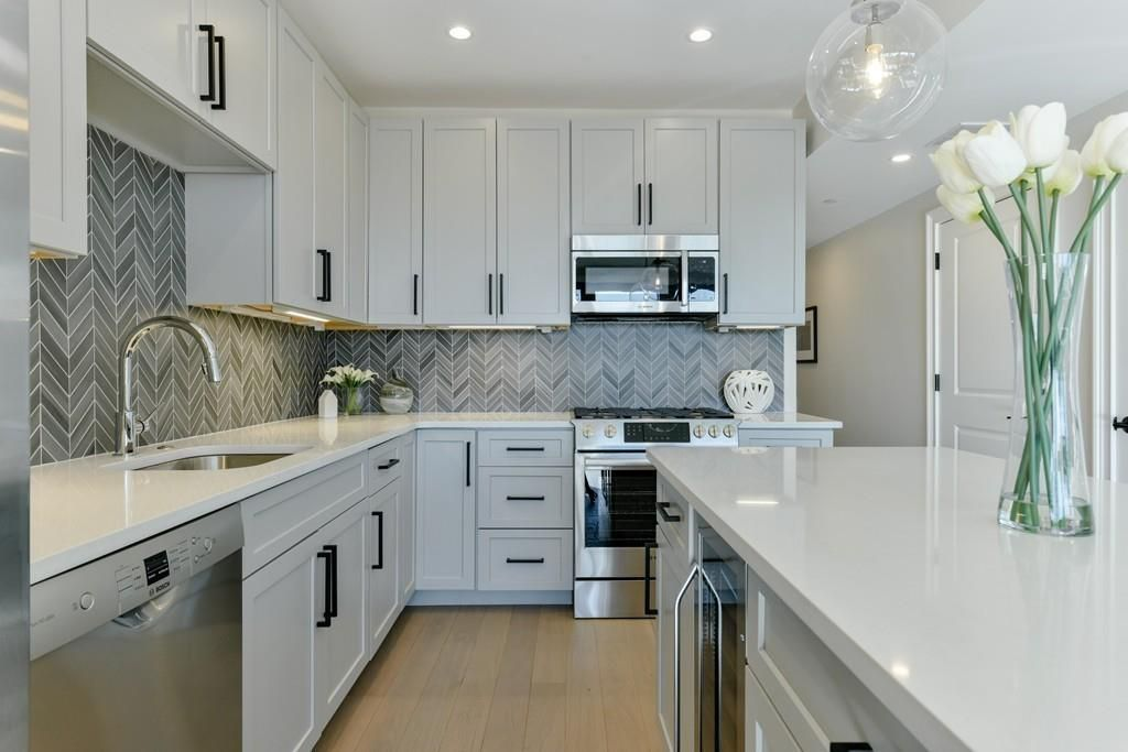 A modern kitchen with cabinetry and an island.