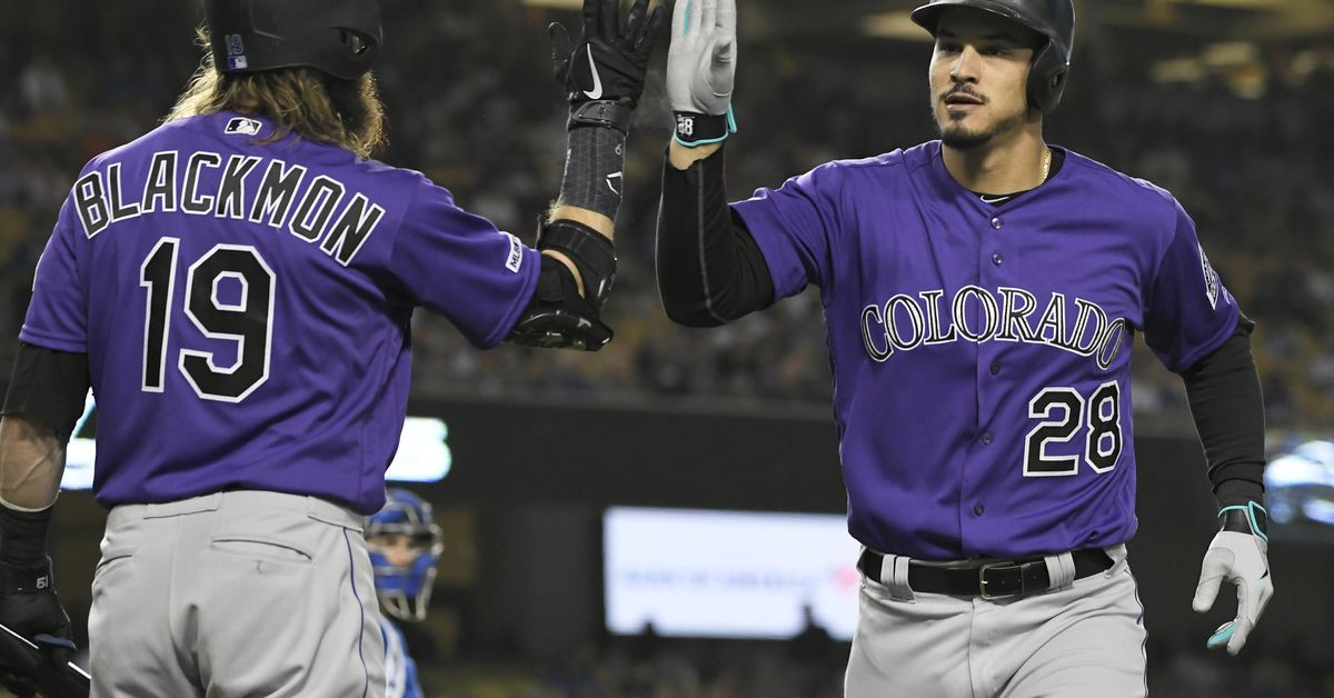 Rockies 4 , Dodgers 3 : Nolan Arenado and Charlie Blackmon lift the team to victory