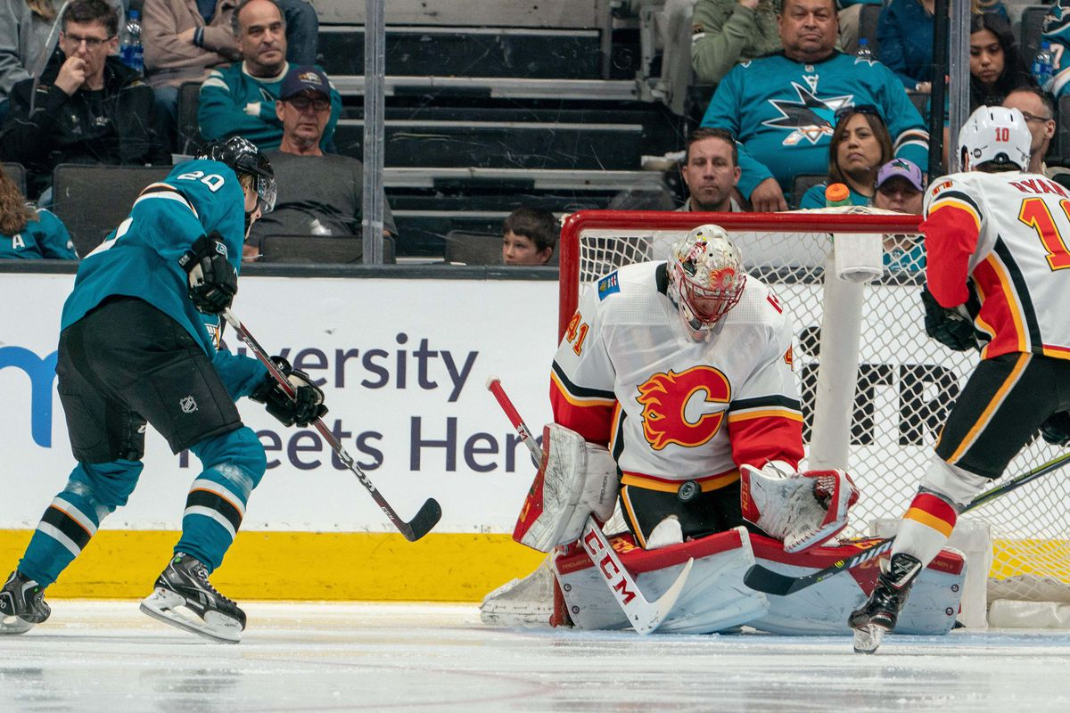 Calgary Flames goaltender Mike Smith (41) makes a save against the shot of ]San Jose Sharks right wing Marcus Sorensen (20) during the third period at SAP Center at San Jose.