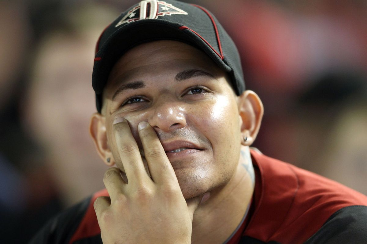 PHOENIX, AZ - JULY 11:  National League All-Star Yadier Molina #4 of the St. Louis Cardinals looks on during the 2011 State Farm Home Run Derby at Chase Field on July 11, 2011 in Phoenix, Arizona.  (Photo by Christian Petersen/Getty Images)