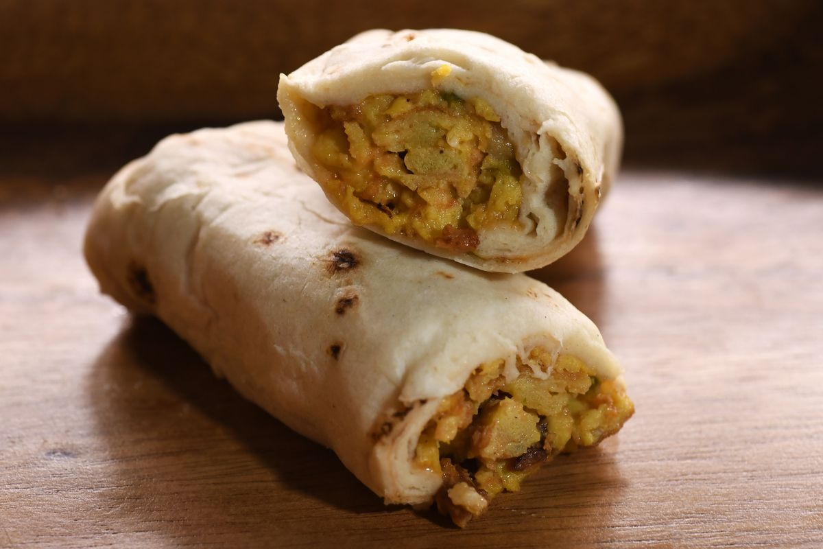 A cross section of a breakfast burrito