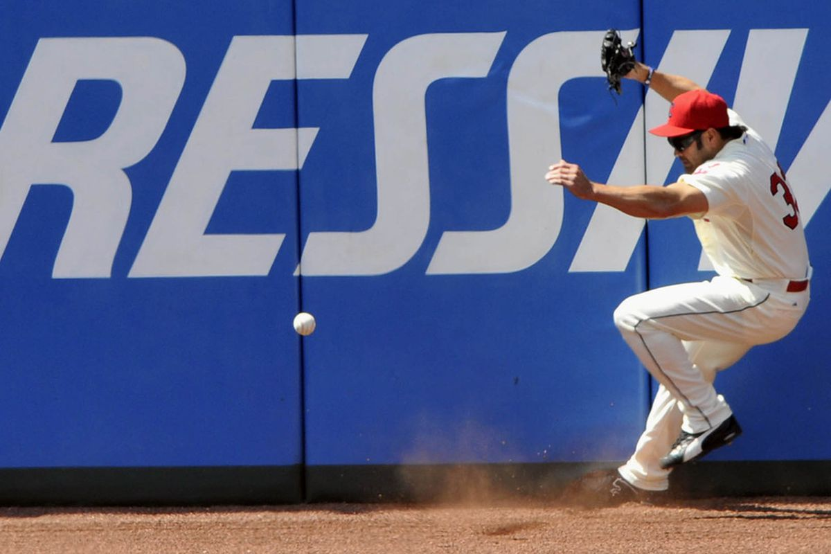 May 20, 2012; Cleveland, OH, USA; Cleveland Indians left fielder Johnny Damon (33) collides with the wall on a double by the Miami Marlins in the eighth inning at Progressive Field. Mandatory Credit: David Richard-US PRESSWIRE