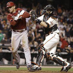 Arizona Diamondbacks' Gerardo Parra, left, is tagged out at home by San Francisco Giants catcher Eli Whiteside.