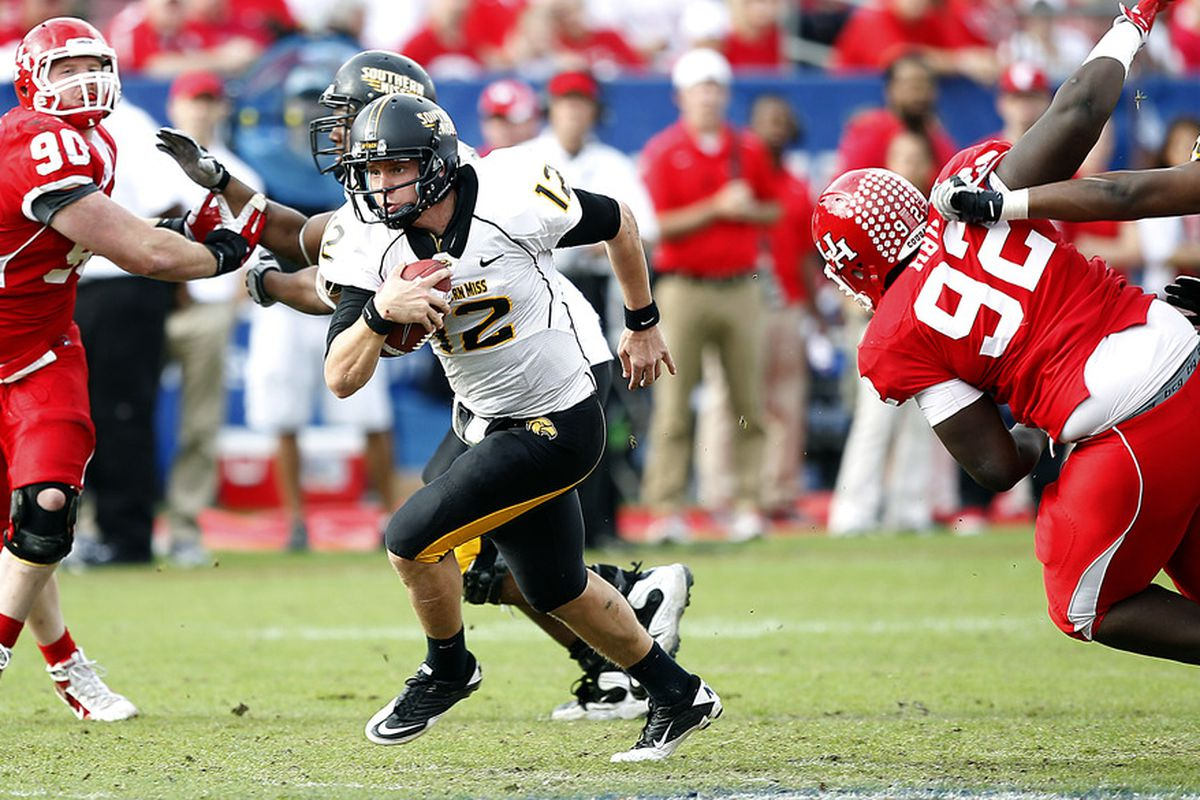 HOUSTON - DECEMBER 03:  Quarterback Austin Davis #12 of the Southern Miss Golden Eagles looks for room to run against the Houston Cougars at Robertson Stadium on December 3, 2011 in Houston, Texas.  (Photo by Bob Levey/Getty Images)