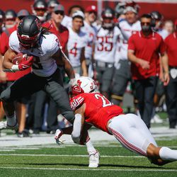Utah safety Brandon McKinney, right, tackles Washington State running back Deon McIntosh (3) during an NCAA college football game at Rice-Eccles Stadium on Saturday, Sept. 25, 2021 in Salt Lake City.