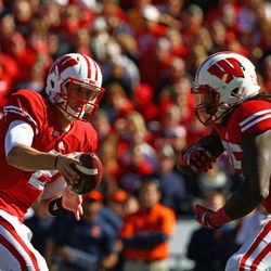 Quarterback Joel Stave extends the ball out to Running Back Melvin Gordon