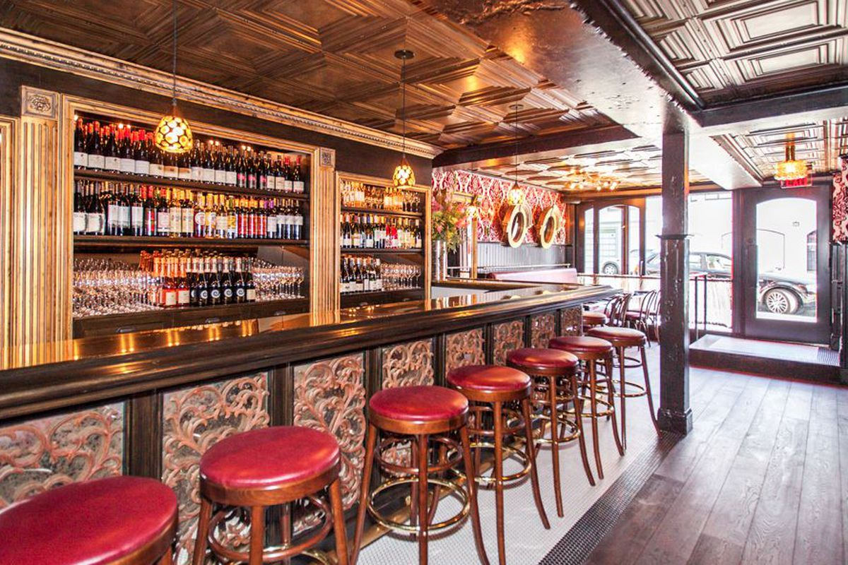 """<a href=""""http://sf.eater.com/archives/2013/09/18/cafe_claude_marina_chic_french_on_greenwich.php"""">Cafe Claude Marina, San Francisco</a>."""