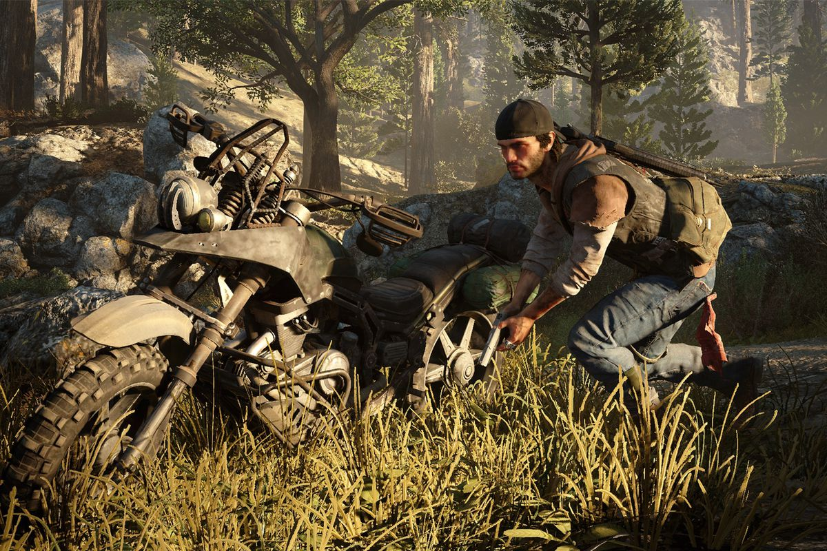 Days Gone - Deacon creeps past motorcycle with drawn pistol