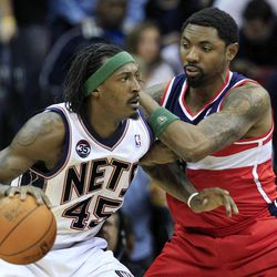 New Jersey Nets' Gerald Wallace, left, dribbles the ball as Washington Wizards' Roger Mason, right, tries to block his path during the first half of an NBA basketball game in Newark, N.J., Friday, April 6, 2012. The Nets won 110-98.