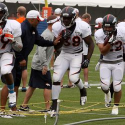Denver Broncos running backs C.J. Anderson, Montee Ball, Jacob Hester and Lance ball work through the ropes