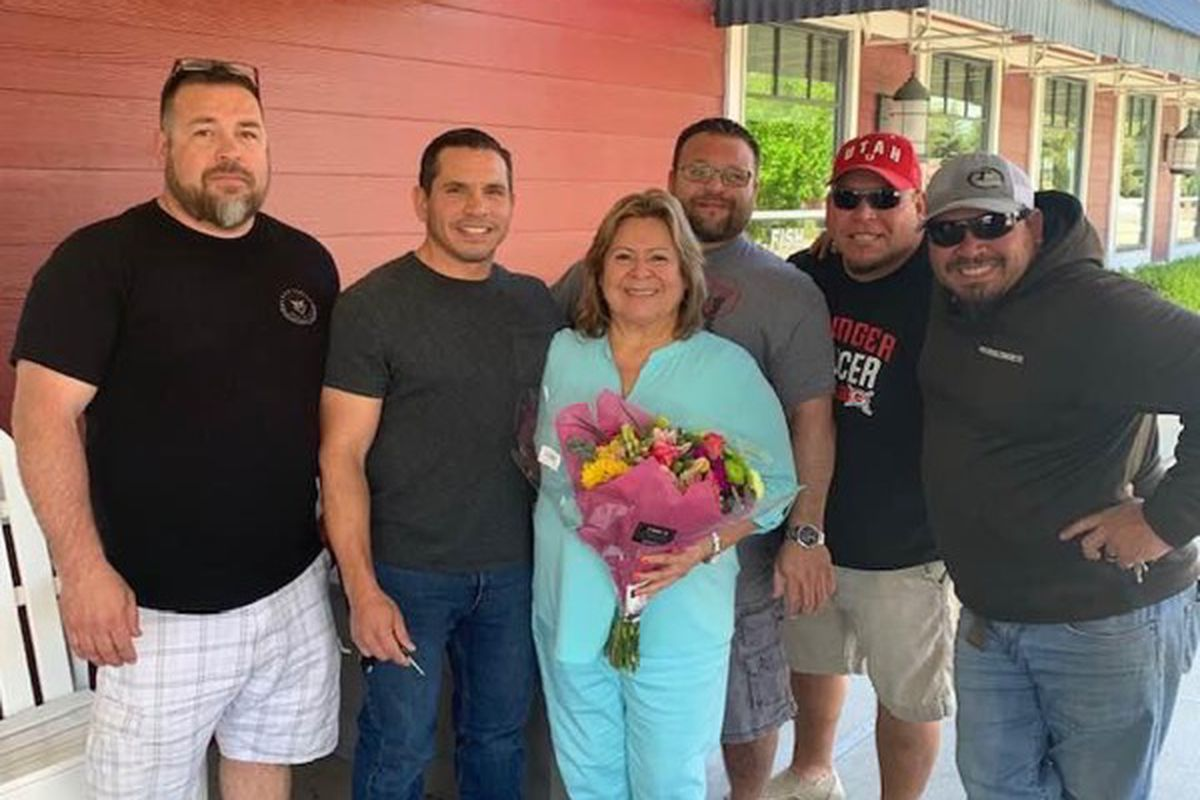 Teresa Vidal, who died from COVID-19 complications in August, in pictured with her five sons. From left to right: Robert Vidal, Tommy Vidal, Kenny Vidal, Sammy Vidal, Danny Vidal.