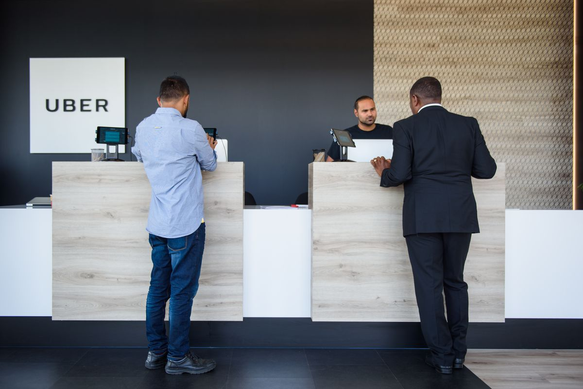 People standing in the lobby of the Uber building