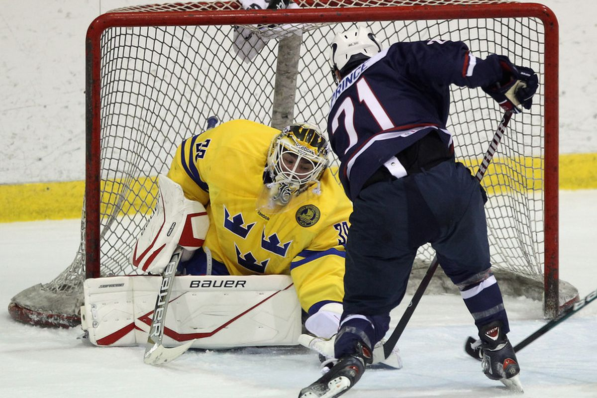 LAKE PLACID, NY - AUGUST 08: Shane Prince #21 of Team USA is stopped by Johan Gustafsson #30 of Team Sweden at the Lake Placid Olympic Center on August 8, 2011 in Lake Placid, New York.  (Photo by Bruce Bennett/Getty Images)